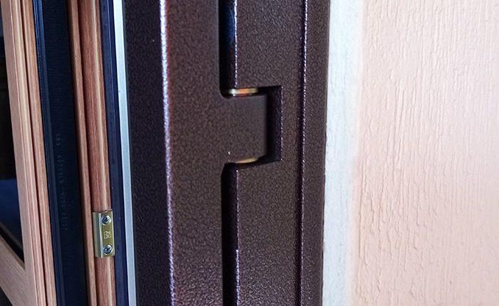 Inferriata su porta finestra con decoro Doppia Borchia tonda centrale marrone 04