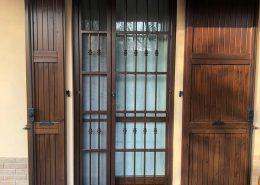 Inferriata su porta finestra con decoro Doppia Borchia tonda centrale rame 01
