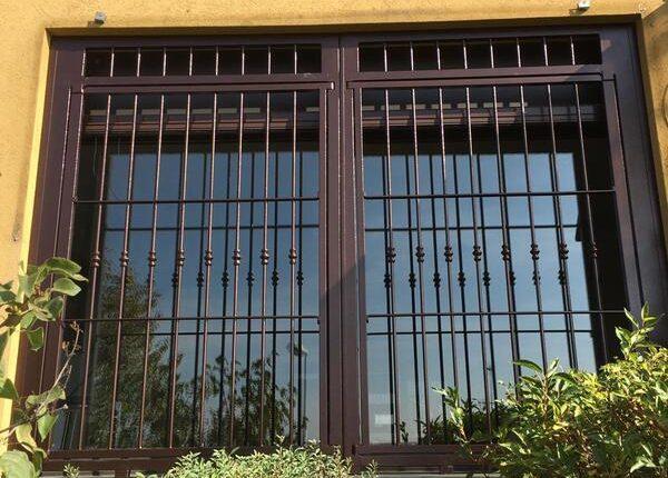 Inferriate per finestre con forme irregolari rame martellato 05